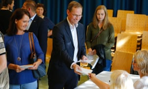Berlin's mayor Michael Mueller receives his ballot papers at a polling station in Berlin.