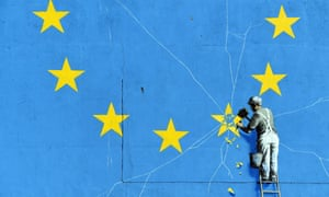 Detail of a Banksy mural showing a man chipping one of the stars off the EU flag