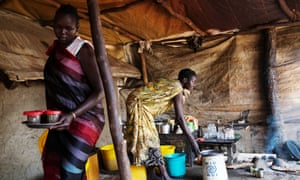 Elizabeth Nyalony, left, a mother of three young children, fled Leer for Nyal, where she has set up a stall selling coffee and tea.