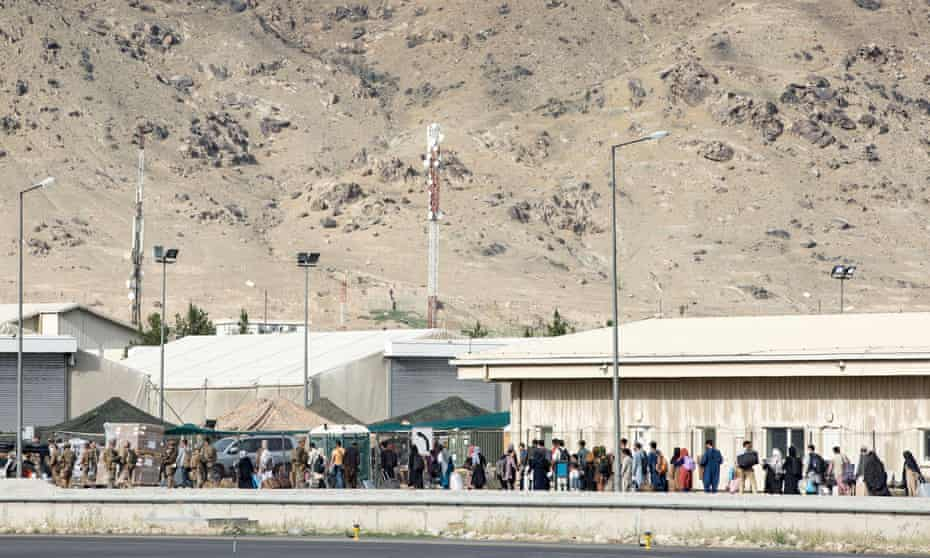 Australian citizens and visa holders queue up to board an evacuation flight in Kabul.