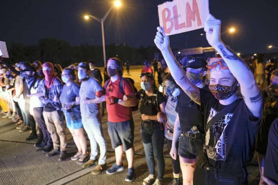 Demonstrators block the I75 highway in Atlanta on Saturday.
