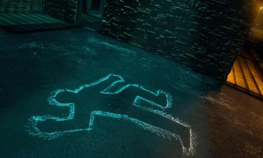chalk outline of body of victim on pavement.