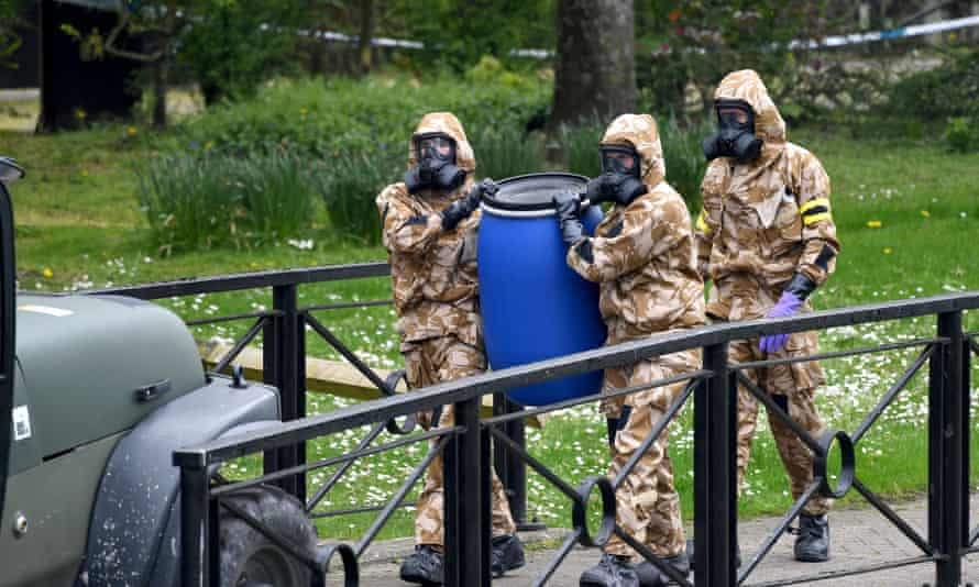 Soldiers in breathing apparatus replace the paving where Sergei Skripal and his daughter collapsed after a nerve agent attack.