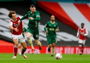 Sheffield United's Scottish striker Oliver Burke runs past Arsenal's Brazilian defender David Luiz