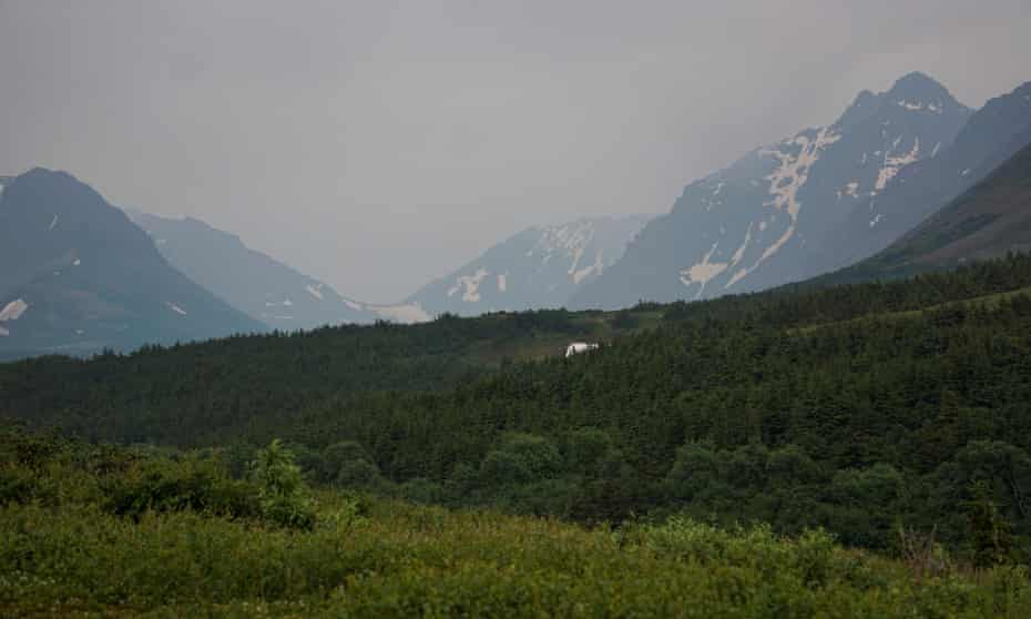 A general view of the mountain valley obscured by smoke taken from the Glen Alps trailhead of Chugach state park in Anchorage, Alaska, on 29 June.