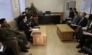 North Korean officials meet a Japanese delegation in October 2014 in Pyongyang for talks over an investigation into abductions of Japanese citizens.