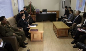 A Japanese delegation (right) in Pyongyang during talks over a special investigation into North Korean abductions in 2014.