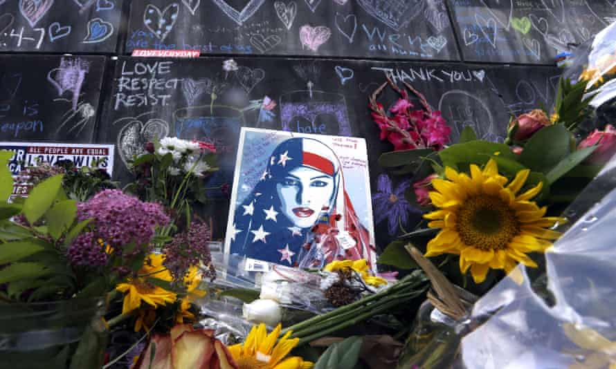 A small portion of the memorial for two men fatally stabbed on a train in Portland, Oregon, in earlier this year.