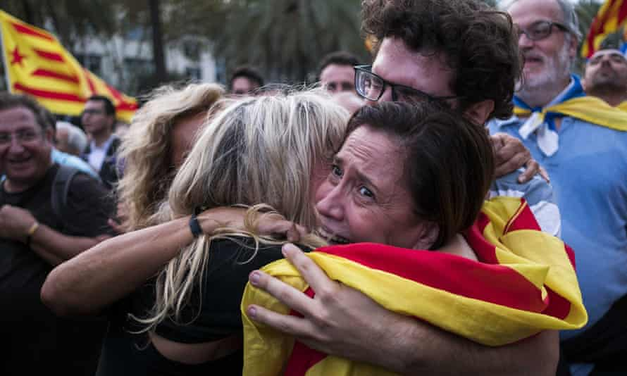 Catalans in Barcelona react to their president's declaration of the right to independence on 10 October 2017