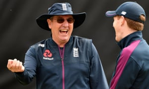England's former cricket coach Trevor Bayliss, left, shares a joke with England captain Eoin Morgan