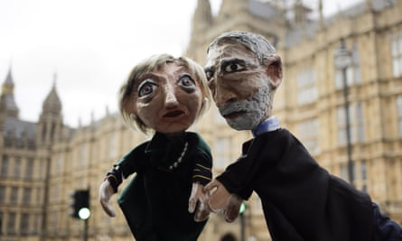 Anti-Brexit activists with hand-puppets of Theresa May and Jeremy Corbyn.