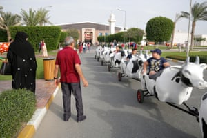 A cow-themed ride taking children around Baladna farm, north of Doha.