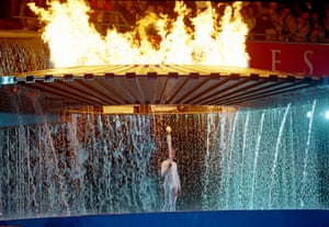 The cauldron containing the Olympic flame rises above torch bearer Cathy Freeman during the opening ceremony.