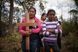 Relatives at the burial of Santos Sevilla