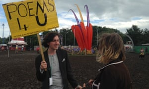 Rowan McCabe offers his services to a festivalgoer.