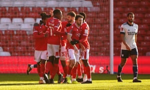 Nottingham Forest players celebrate the first goal of the day.