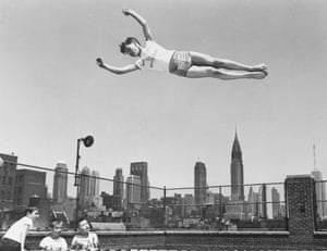 The Chrysler building, in the background, became a popular backdrop in photographs. Here, Larry Schwanzer demonstrates his prowess on the home-made trampoline built by Larry and his buddies on the roof of the Madison Square Boys' Club
