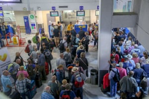 People line up in front of a counter of Thomas Cook at the Heraklion airport on the island of Crete, Greece September 23, 2019 REUTERS/Stefanos Rapanis