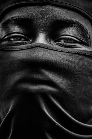 """Nicola Vigilanti: Cannot Breathe (single image winner)Despite the pandemic, an unprecedented global outrage was sparked by the death of black American George Floyd. Picture taken in Lyon, France on the 13th June 2020. """"A powerfully emblematic image of a Black Lives Matter protestor with a face covering pulled so tightly that it emulates the personal struggle of George Floyd to breathe. This portrait is so important in bringing attention to this centuries-long fight against racism and injustice. For the photographer making the image and for a jury to recognise its impact is a signal in a long overdue call for change in society but also in our own industry"""" - Fiona Shields, Head of Photography at the Guardian"""