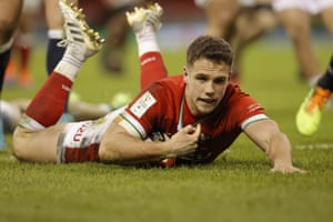 Wales' Keiran Hardy runs through to score his side's third try.