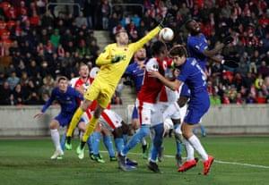 Slavia Prague's Ondrej Kolar attempts to punch under pressure from Antonio Rudiger, Olivier Giroud and Marcos Alonso.