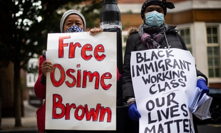 Demonstrators outside the Home Office call for the release of Osime Brown.