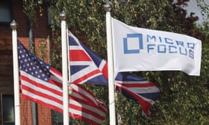 Flags outside Micro Focus's offices in Newbury, Berkshire.