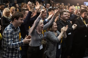 Lib Dems cheer their winning candidates during the count for seats in North West England at Manchester central convention complex