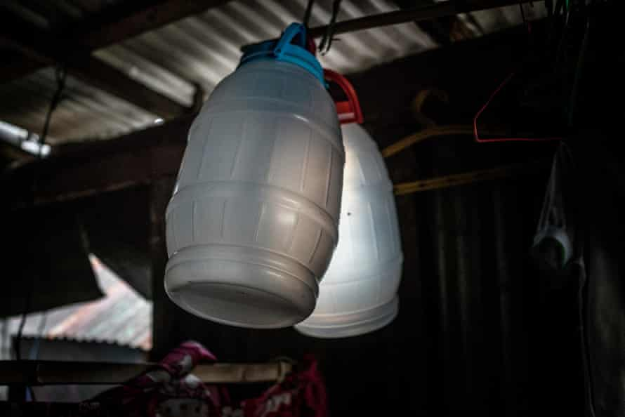 Containers hang from the rafters of Jasmine Durana's house