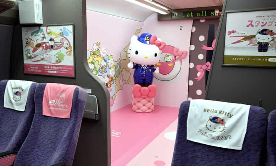 A life-sized doll greets passengers inside Japan's first Hello Kitty bullet train.