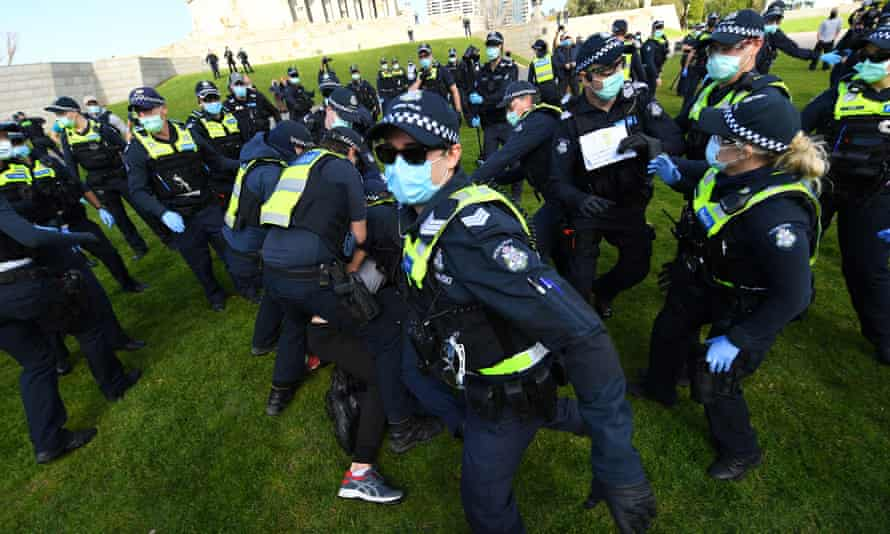 Protesters scuffle with Victorian police at the anti-lockdown 'Freedom Day' protest on Saturday.