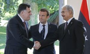 Macron (centre) with Fayez al-Sarraj and Gen Khalifa Haftar last summer.