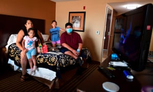 Ruben Navarette, 14, (right) sits in a hotel room with his aunt Jamie Smith and cousins Julissa (2nd from right) and Jeorgina, where they have been temporarily located in Fresno, California after he had to drive for the first time when escaping the Creek Fire on Labour Day from his home in Tollhouse, California.