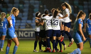 Tottenham Hotspur players celebrate after an own goal scored by Karima Taieb of Manchester City.