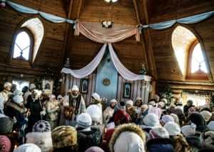 A priest leads a ceremony inside the temple of Vissarion in Petropavlovka, Siberia
