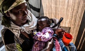Madeleine Kidolo, a mother of six children in the town of Minova, in DRC's South Kivu province, with her youngest child