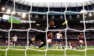 Harry Kane of Tottenham Hotspur scores his team's second goal past Aston Villa keeper Tom Heaton.