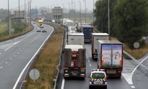Truckers slowing down traffic on a road near Calais, France.