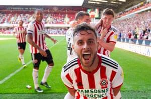 George Baldock of Sheffield United celebrates his goal.