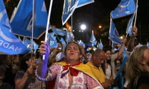 Supporters of Mariano Rajoy, Spain's acting prime minister, and his People's party