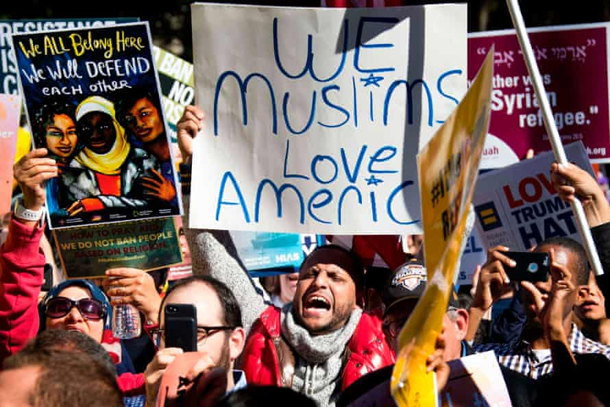 Demonstrators chant during a #NoMuslimBanEver rally on 18 October