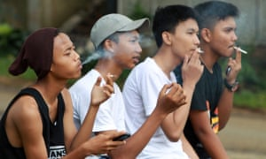 High school students smoke cigarettes after class in Bogor, Indonesia.
