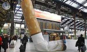 A symbolic cigarette butt inside Gare de Lyon railway station in Paris