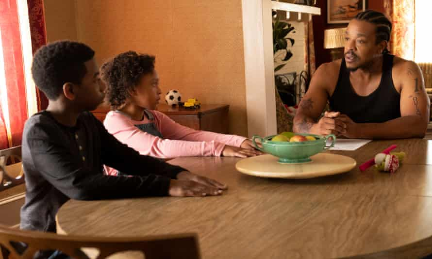 Russell Hornsby, right, in The Hate U Give film adaptation (2018).