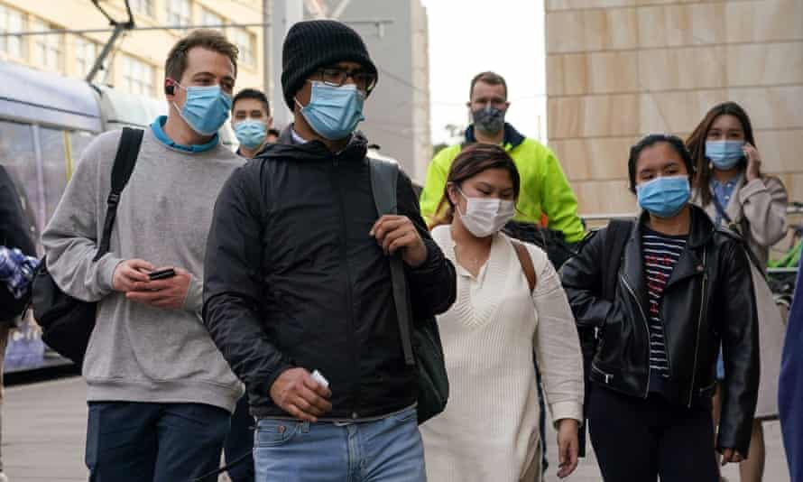 Commuters wear face masks as they enter Sydney's Central Station