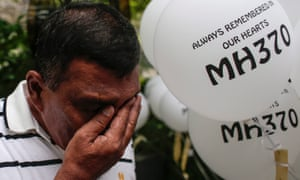 Zamani Zakaria grieves for his son and daughter-in-law at a ceremony to mark two years since MH370 disappeared.