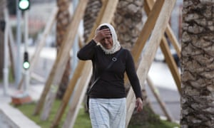A woman cries asking for her son as she walk near the scene of the attack in the French resort city of Nice, southern France