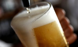 Pint of beer being poured