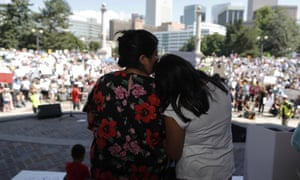 Brenda Villa, left, comforts her 11-year-old daughter, Kathryn, after speaking during an immigration rally and protest in Civic Center Park Saturday, June 30, 2018, in downtown Denver.
