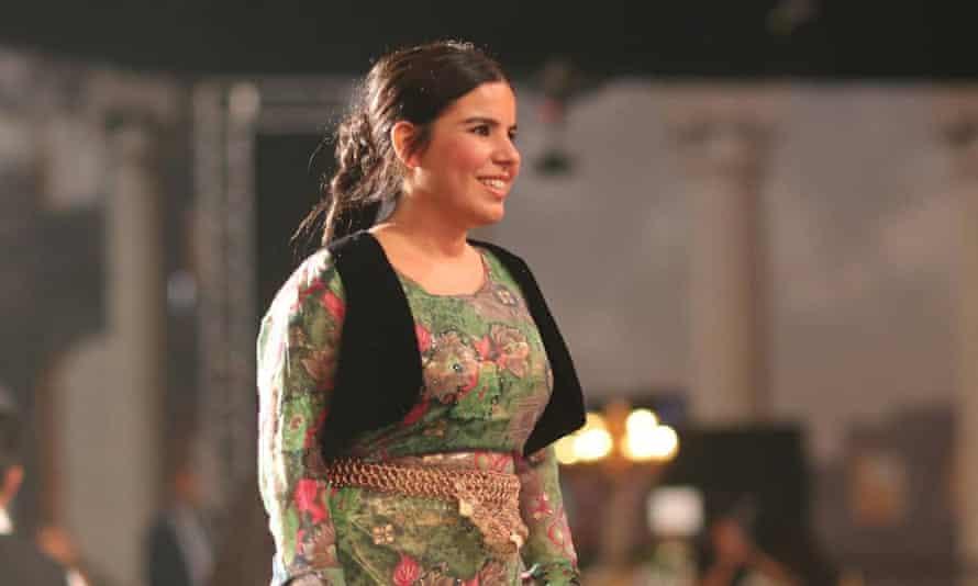 Zehra Doğan wearing green dress and smiling